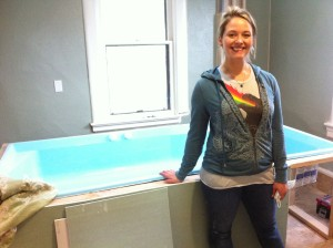 Sandra proudly shows off our Infinity Tank during construction